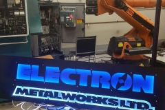 backlit electron metalworks signage